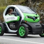 electric car driving on road