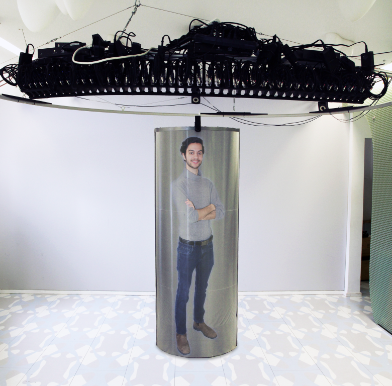 man in holographic video machine