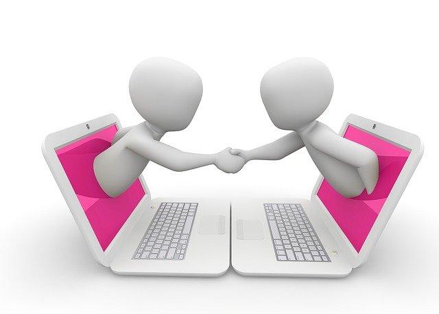 laptop figures shaking hands
